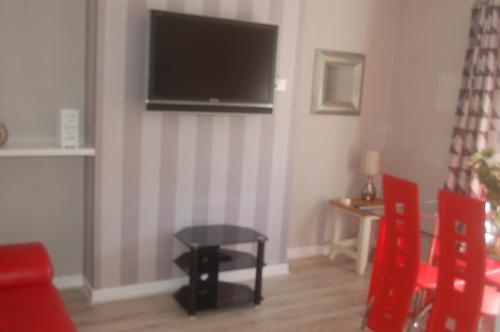 A television and/or entertainment center at elegant apartment in knightswood area of glasgow