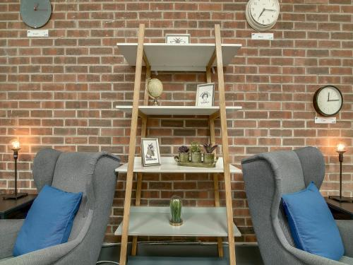 A seating area at Living by BridgeStreet, Manchester City Centre