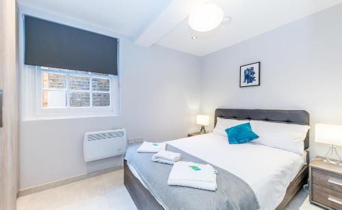 A bed or beds in a room at Chic Apartments in the heart of Camden by City Stay London