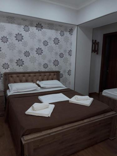 A bed or beds in a room at Guesthouse Fatima