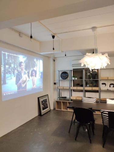 A television and/or entertainment center at Grey Sheep Hostel