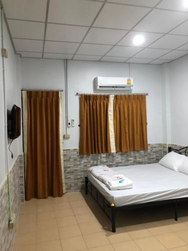 Cama o camas de una habitación en Baan Khun Noo