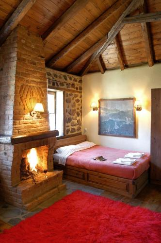 A bed or beds in a room at Agios Germanos Traditional Hotel