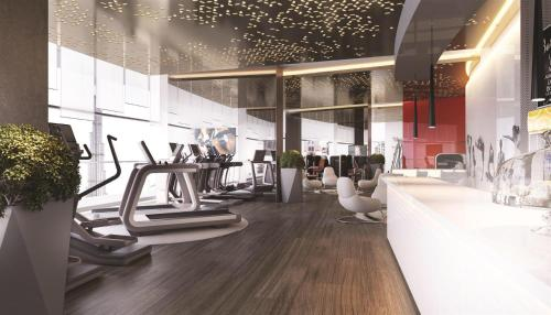 The fitness center and/or fitness facilities at DAMAC Towers by DAMAC Living