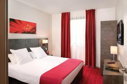 Un ou plusieurs lits dans un hébergement de l'établissement Appart'City Confort Grenoble Inovallée