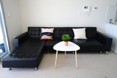 A seating area at Burwood heart one bedroom stunning view &nice furnitures