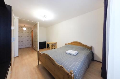 Кровать или кровати в номере Апартаменты Авиатор