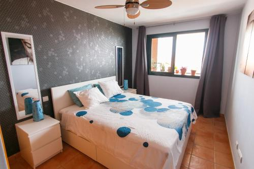 A bed or beds in a room at Paraiso 1
