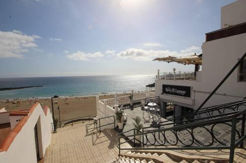 A balcony or terrace at Luxury Apartment Cristianos Beachfront