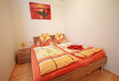 A bed or beds in a room at Appartementhaus Crystal by Schladming-Appartements