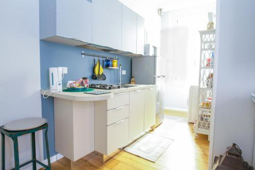 A kitchen or kitchenette at Cavour Apartment
