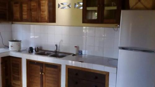 A kitchen or kitchenette at La Maison Maurice