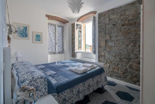 Un ou plusieurs lits dans un hébergement de l'établissement Oceano d'Amore