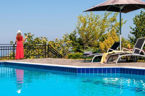 The swimming pool at or near Villa Nefeli