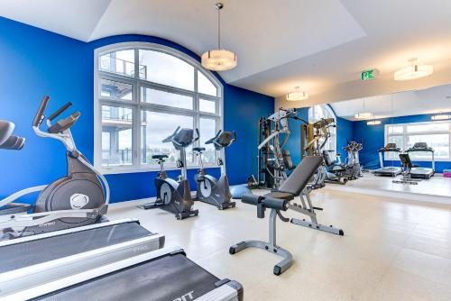 The fitness center and/or fitness facilities at Kanata Lakes Apartments by Corporate Stays