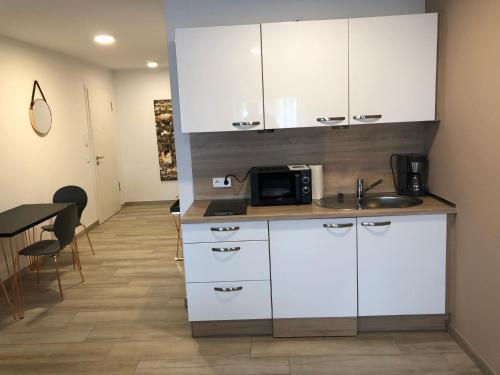 Una cocina o zona de cocina en LuxApartments