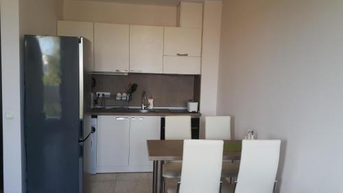 A kitchen or kitchenette at Апартамент Тройката