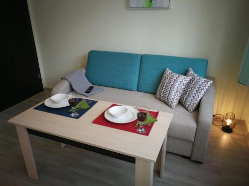 A seating area at All Seasons Apartments Iglika 2
