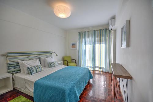 A bed or beds in a room at In Faro with Sea View
