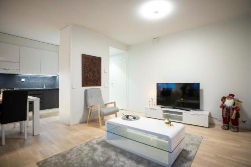 A television and/or entertainment center at Residence Eliel