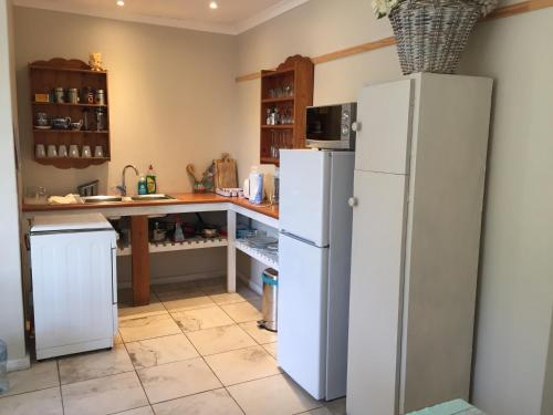 A kitchen or kitchenette at Heron Chase Self-Catering Holiday Home