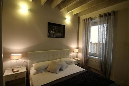 Postelja oz. postelje v sobi nastanitve Florence Apartment Sleeps 4 Air Con WiFi
