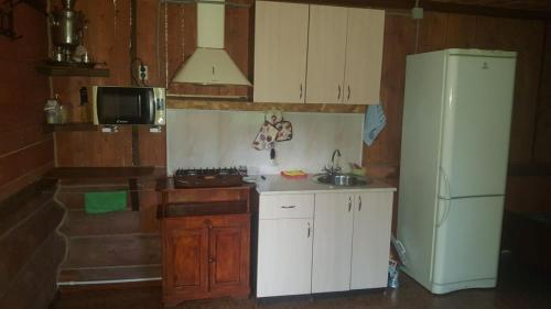 Кухня или мини-кухня в Домик в горах