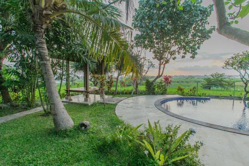 The swimming pool at or near Villa D'Carik Bali