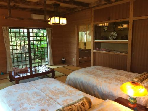A bed or beds in a room at Ishigakijima Pacific Club