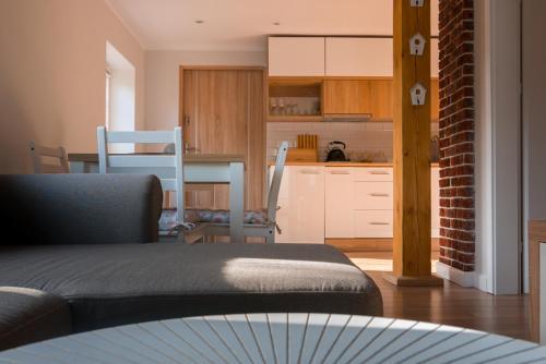A kitchen or kitchenette at Apartamenty Sami Swoi