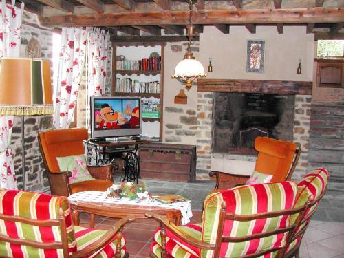Coin salon dans l'établissement Holiday home La Haute Bignetière