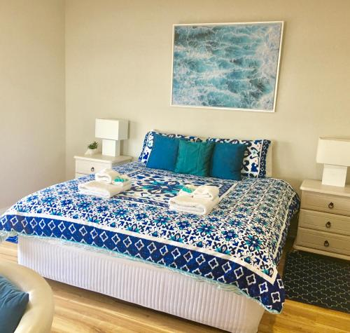 A bed or beds in a room at Shades of Blue Eco Retreat