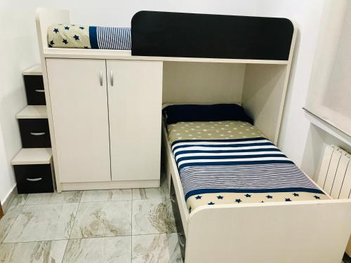 A bed or beds in a room at Best apartment near REAL MADRID Stadium