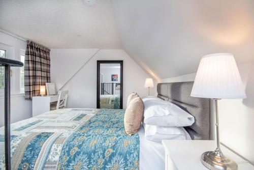 A bed or beds in a room at Hayloft
