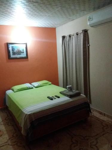 A bed or beds in a room at Residencial Mi Feria