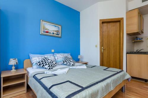 A bed or beds in a room at Vila Brasina