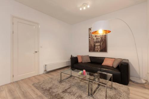 A seating area at Luxury Amsterdam City Center Apartments
