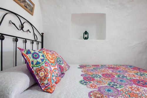 Cama o camas de una habitación en Casa Cueva Calatrava