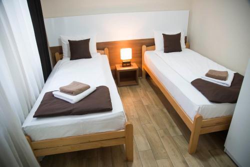 Krevet ili kreveti u jedinici u okviru objekta Bridge Apart Belgrade