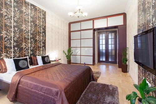 A bed or beds in a room at KAZA APART
