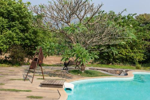 The swimming pool at or near SaffronStays Beyond