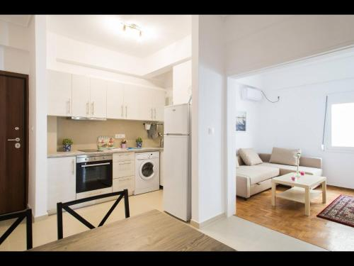 A kitchen or kitchenette at Acropolis Athens Amazing New Flat