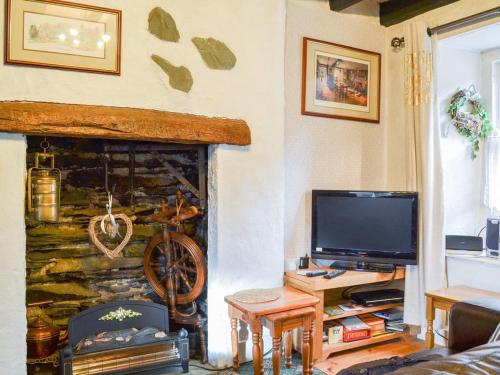 A television and/or entertainment center at Couter Cottage