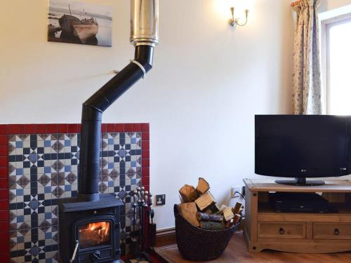 A television and/or entertainment center at Stables Cottage