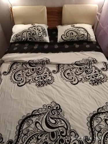 Кровать или кровати в номере Квартира на Патоличева 29