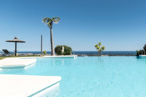 The swimming pool at or near Quartiers Marbella - Apartment Hotel & Resort