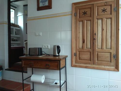 A kitchen or kitchenette at ÁTICO CENTRICO VISTAS ALHAMBRA