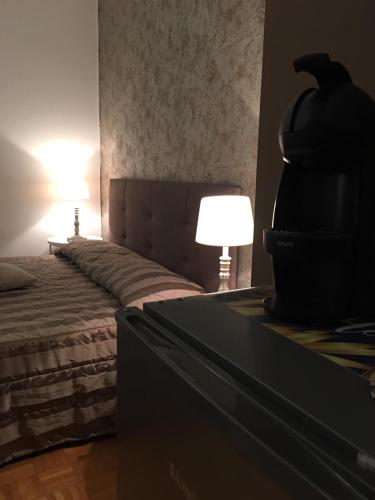 A bed or beds in a room at Corso Italia Rooms