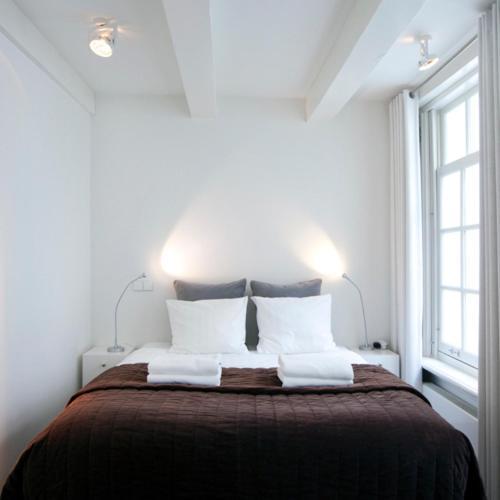Ein Bett oder Betten in einem Zimmer der Unterkunft Charles Apartments