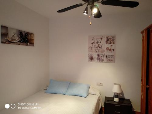 A bed or beds in a room at Apartamento Caleta Caballo